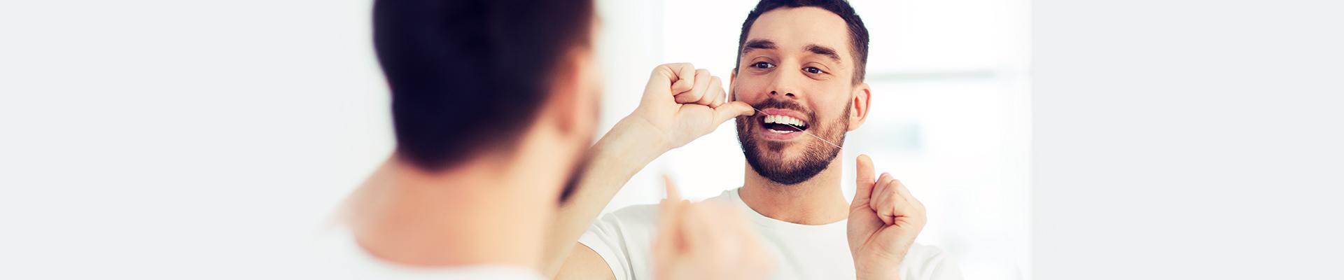 Perio – Man Flossing