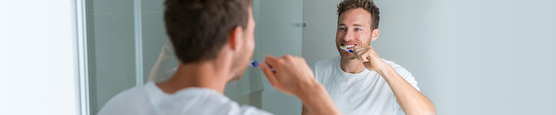 Protect Your Oral Health – Man Brushing